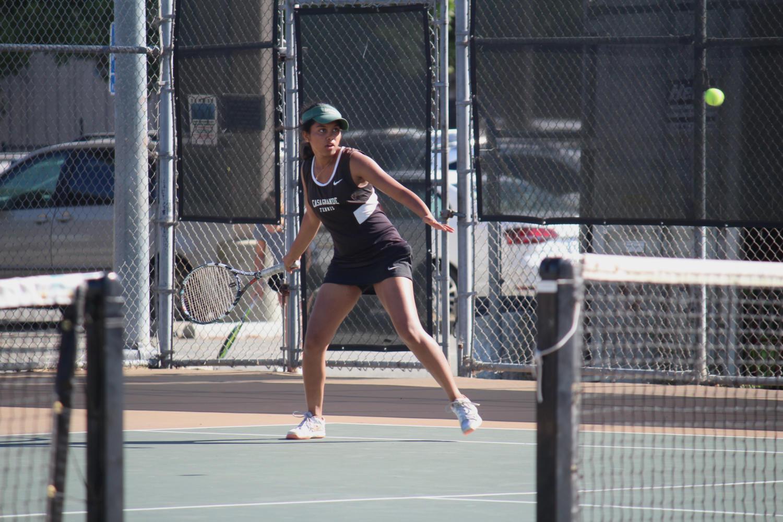 Samveda Ruk, a junior, is poised to swing her racket.
