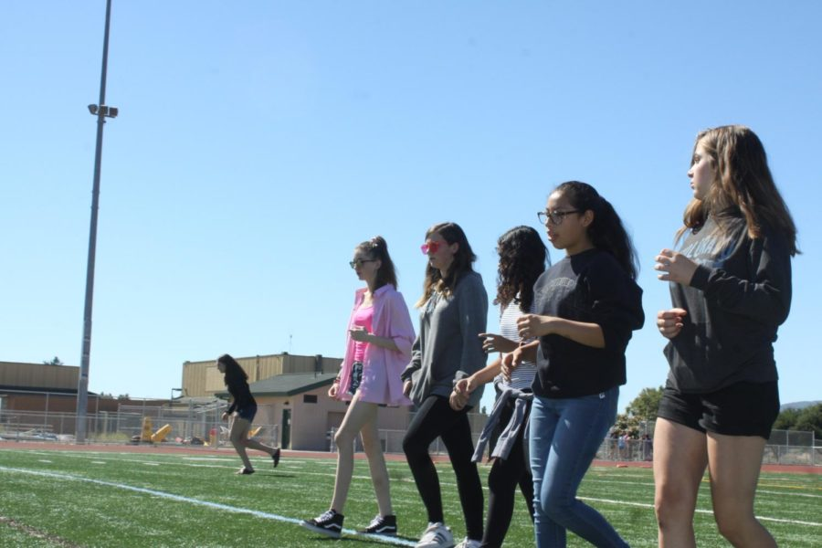 Band students training for the coming season by practicing their marching routines