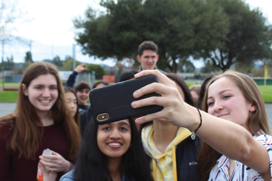 Students take a selfie after a school fire alarm is pulled.