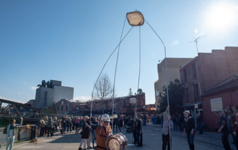 The public gathered on Water Street to watch Goggin set up a model of what his piece will look like.
