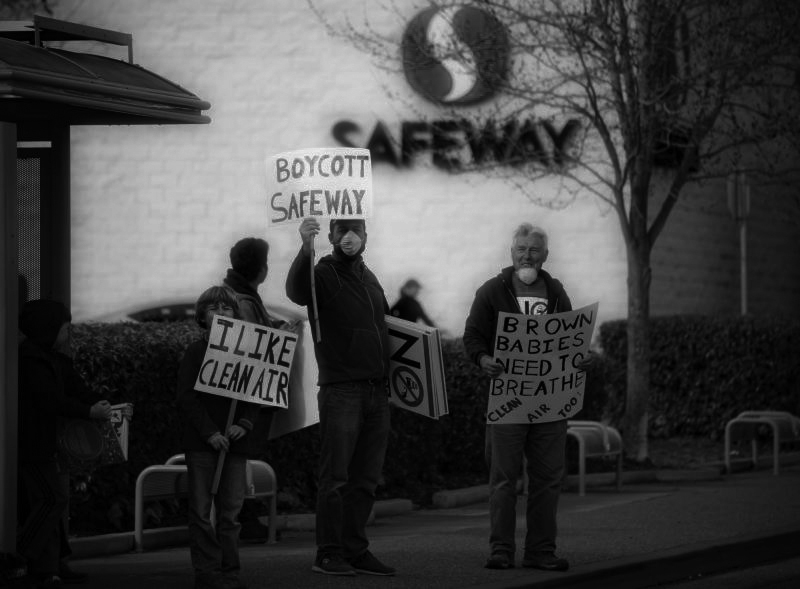 Protestors of the new Safeway gas station stand near the proposed location.