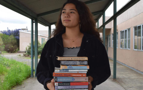 Reporter Taya Llapitan holds some staples of the school's literature curriculum.