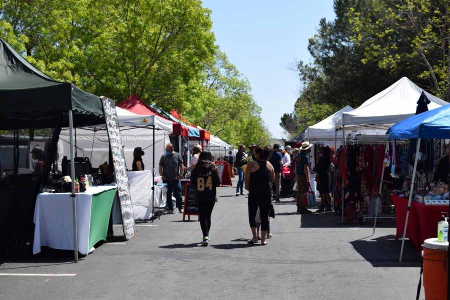 People gather at the Petaluma East Side Farmers Market at Lucchesi Park, which takes place every Tuesday from 10am-1:30 p.m..