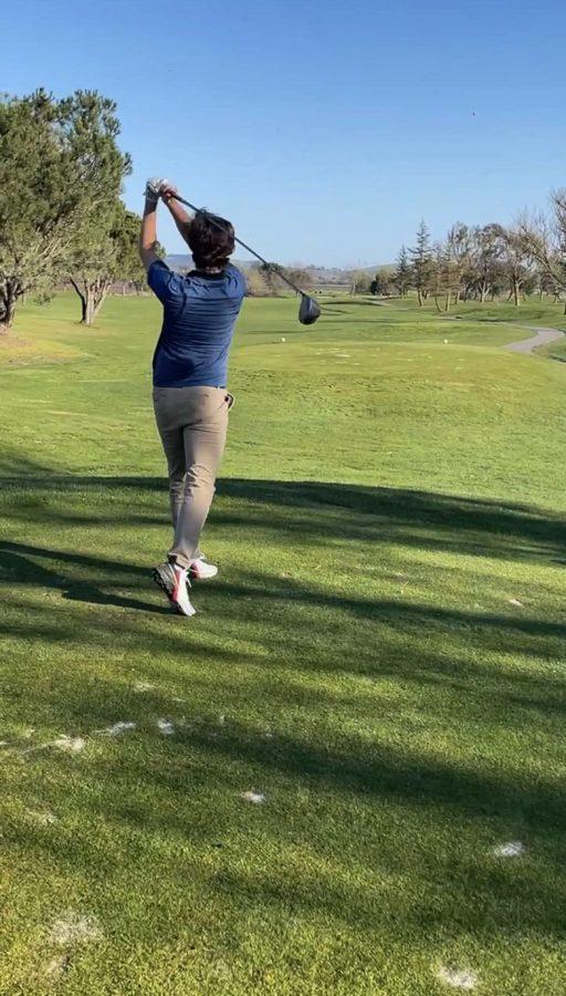 Jacob Reuser, junior, practicing golf.